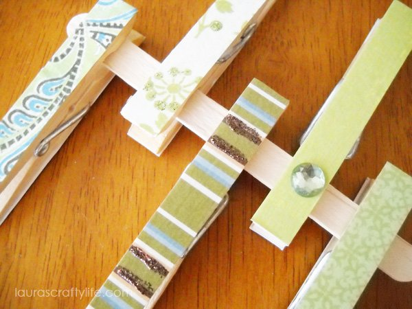 Green decoupaged clothespins - close up
