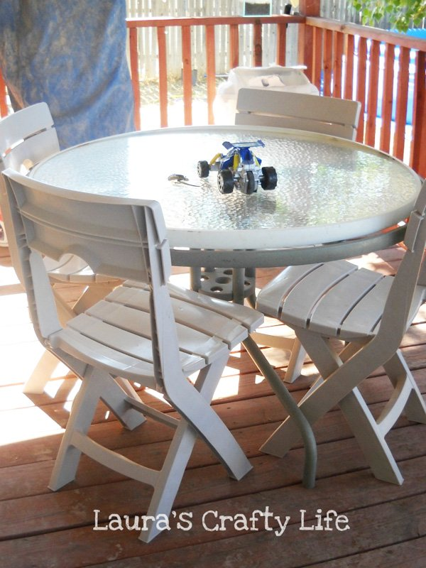 patio table before with plastic chairs