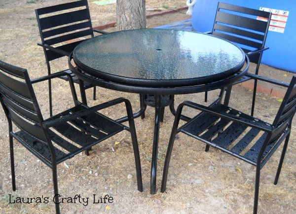 spray painted patio table with metal chairs