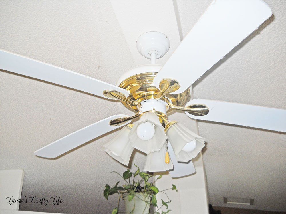 Brass and white ceiling fan
