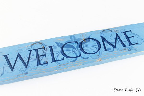 Wooden welcome sign with vinyl from Dollar Tree