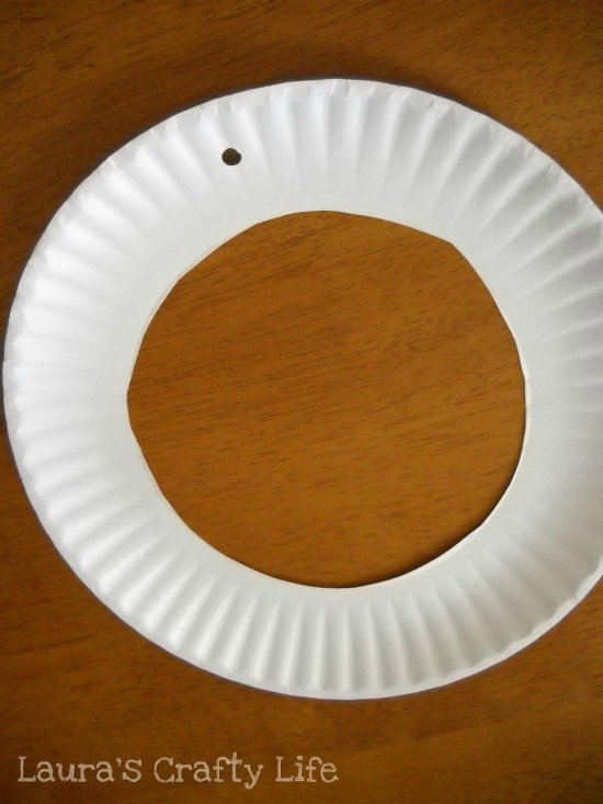 cut hole in paper plate