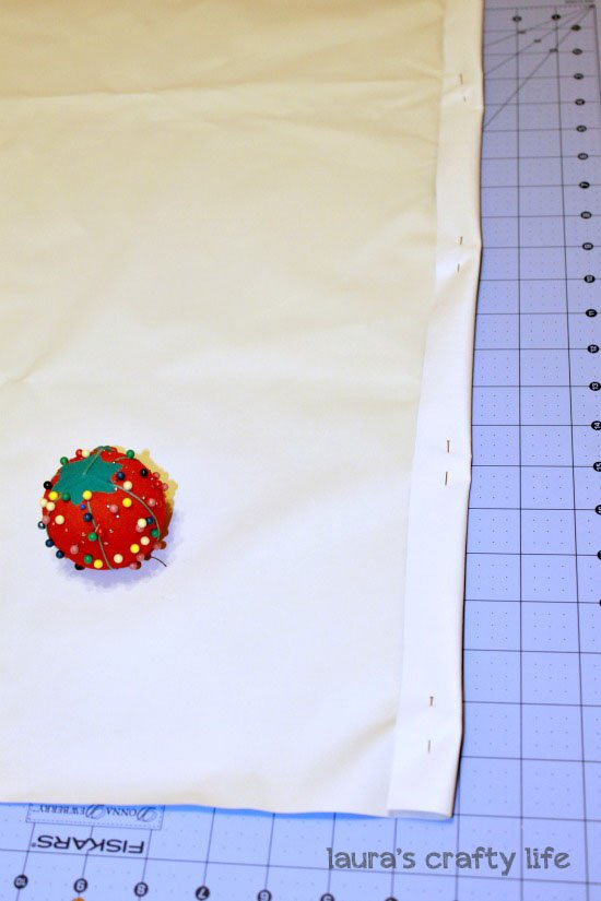 Pin edge of fabric with seam allowance