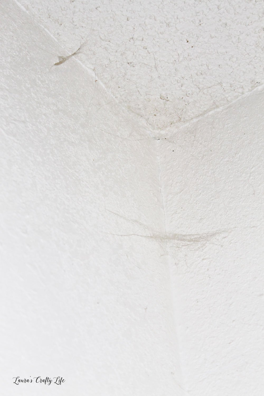 Dirty cobwebs in corner of room