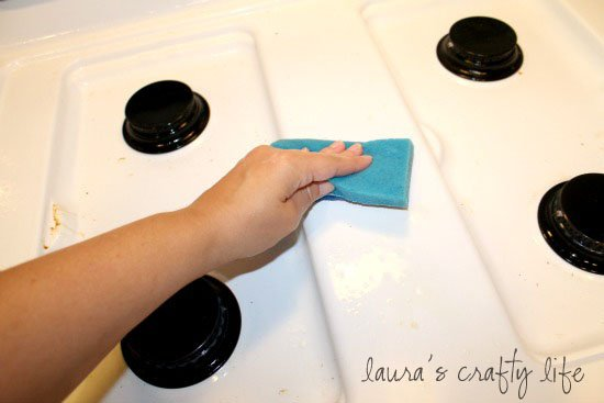 Scrub stove top with a gentle scrubber