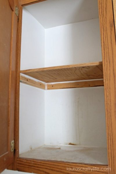 add caulk and wood filler to cabinet