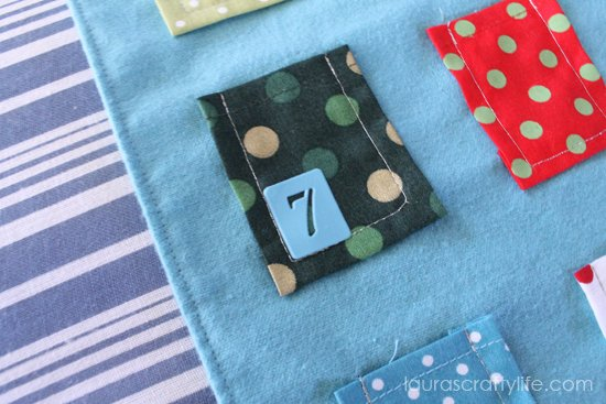 apply adhesive stencil to fabric