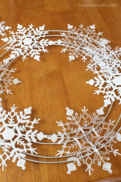 glue clear snowflakes to frame