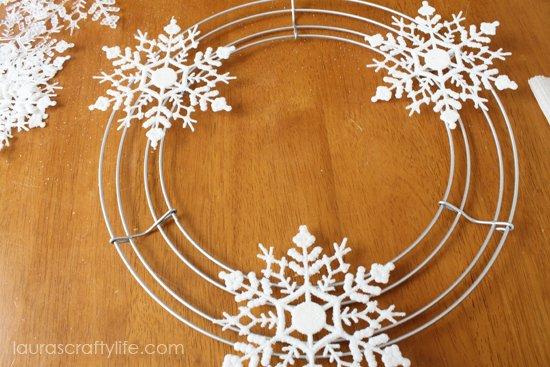glue white glitter snowflakes on frame