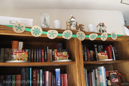 bookshelf snow display with gingerbread houses