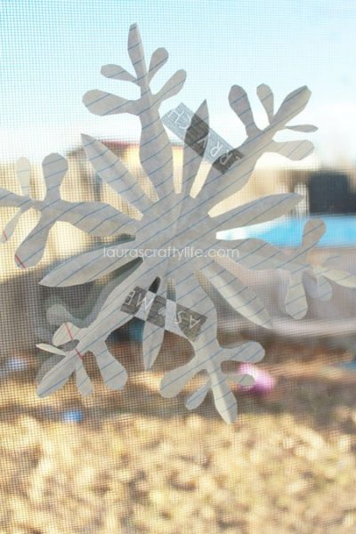 hang paper snowflakes with washi tape
