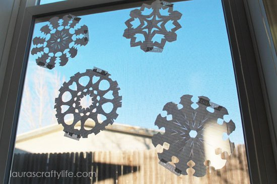 paper snowflakes on window