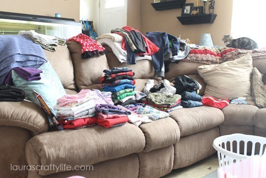 laundry piled on couch