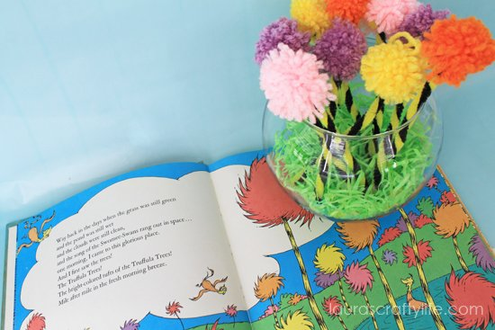 open Lorax book with trees