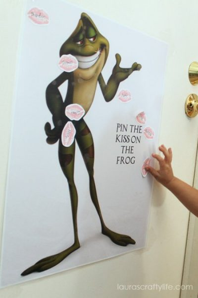 playing pin the kiss on the frog game