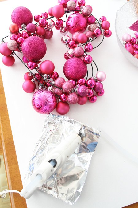 use glue gun to secure ornaments together
