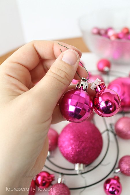 use two smaller ornaments on the wire