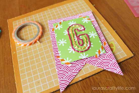use washi tape to embellish banner