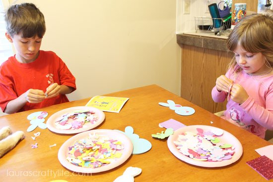 kids working on foam Easter craft