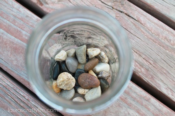 fill bottom of mason jar with stones