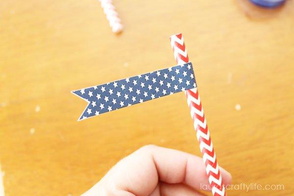 pinch straw flag adhesive around straw