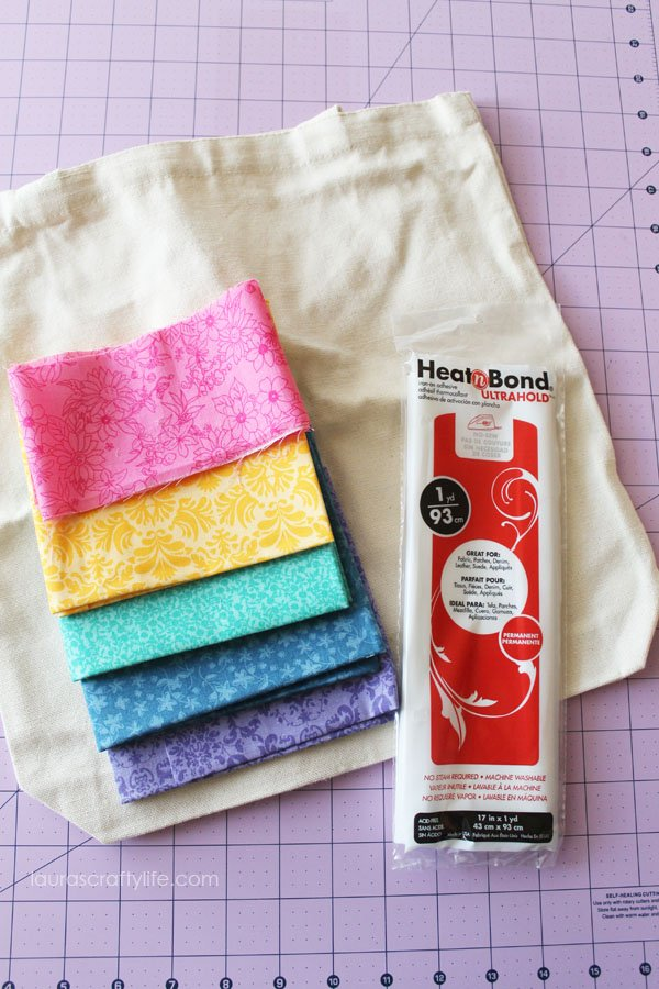 Supplies for no-sew ruffled lace canvas tote