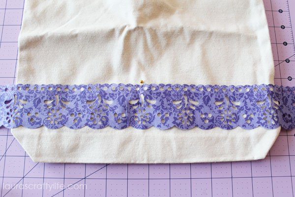 Use first pin to secure lace to middle of tote