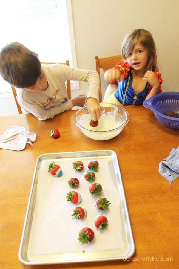 kids making chocolate dipped strawberries