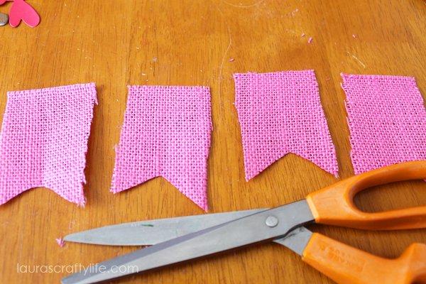 Cut burlap into banner shapes