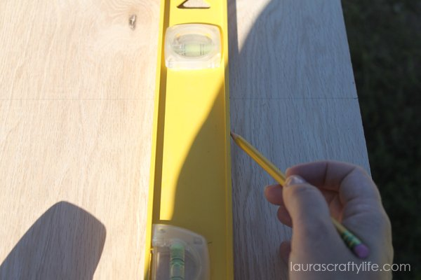 measure and mark cuts on wood