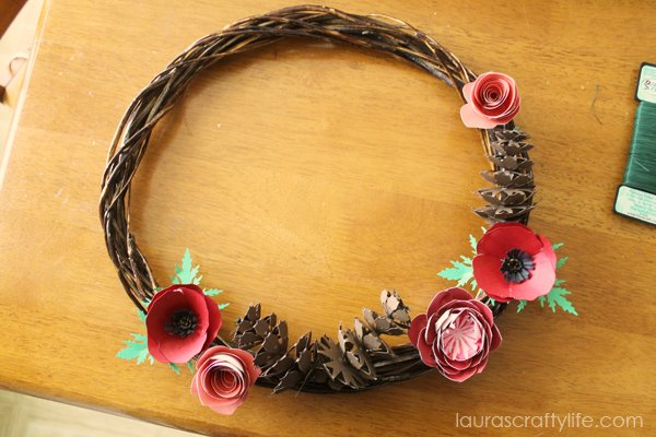 Add largest flower components to wreath