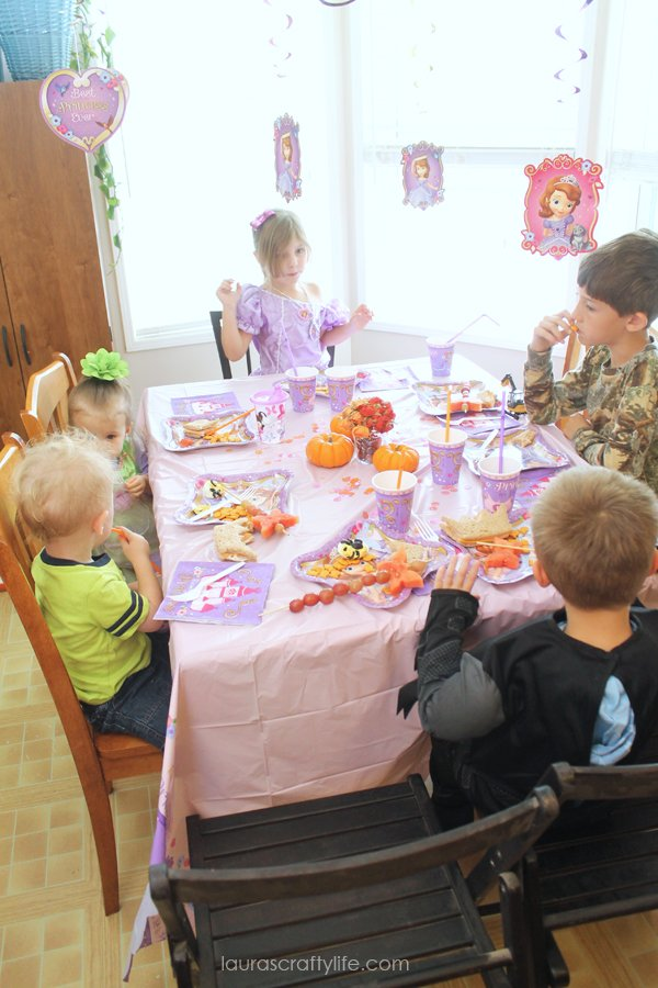 Eating food at the Sofia the First Halloween play date