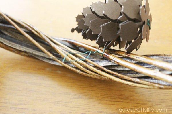Loop floral wire around wreath form