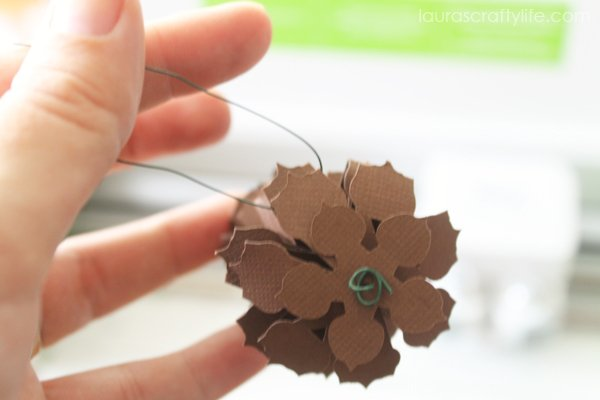 Loop floral wire through one of the pine cone points