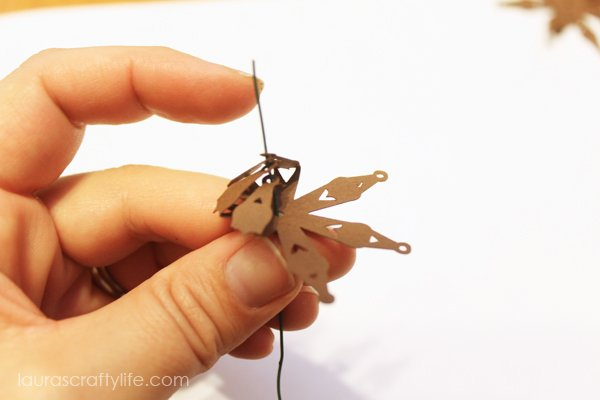 Poke floral wire through holes in pine cone cut out