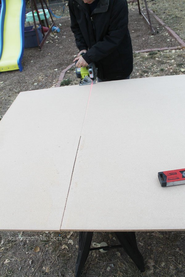 Cut larger piece of plywood to 4 foot by 2 foot