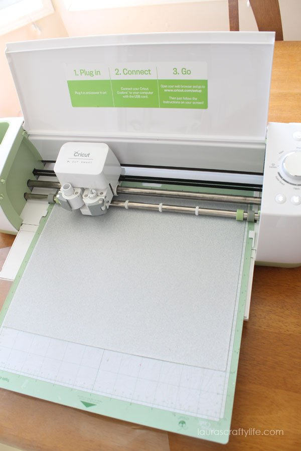 Load iron-on glitter vinyl shiny side down onto Cricut mat