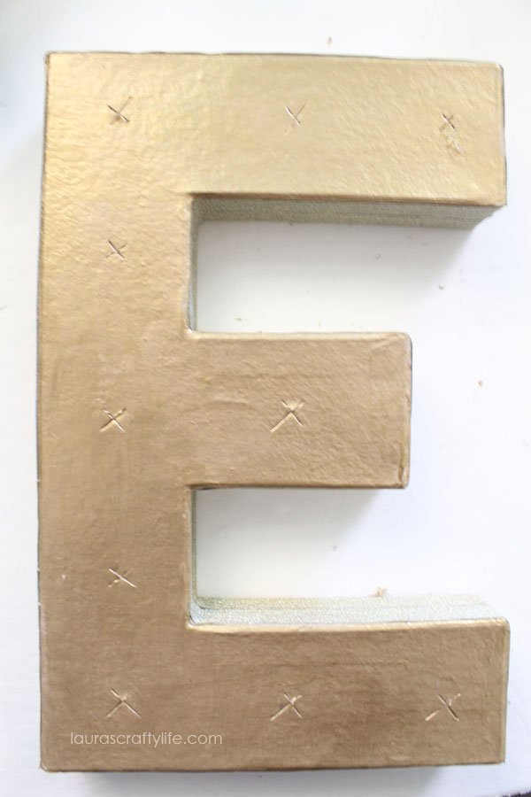 Mark placement for light bulbs on letters, then cut an X with X-ACTO knife
