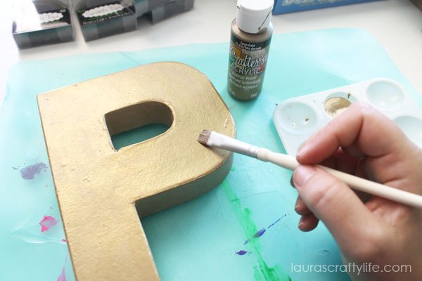 Paint paper mache letter with Spun Gold paint