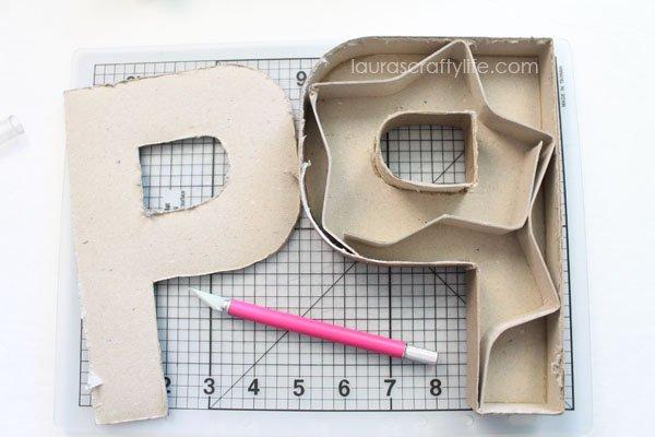 Paper mache letter cut apart