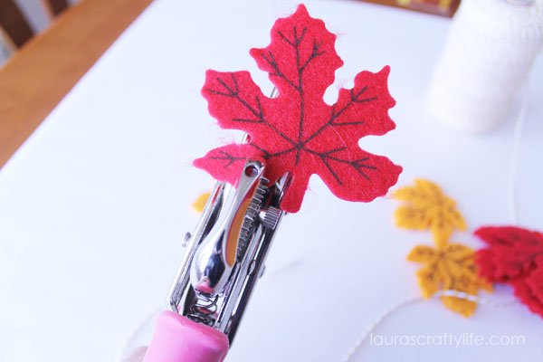 Use Crop-o-Dile to punch holes in felt leaves