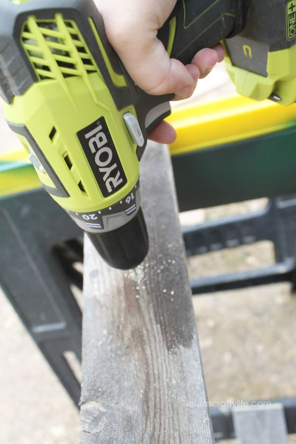 Use Ryobi drill to pre-drill hole in fence slat