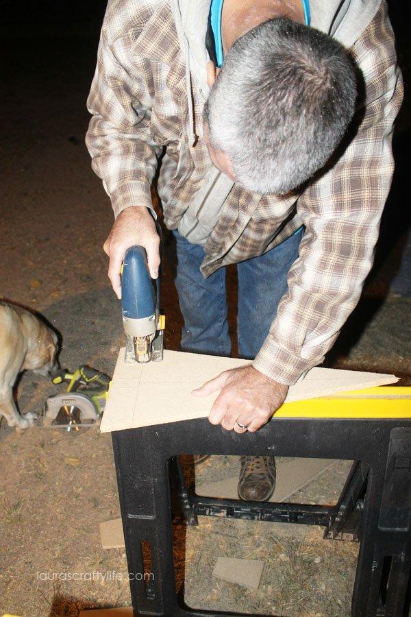 Use Ryobi jig saw to cut trunk and base of Christmas tree