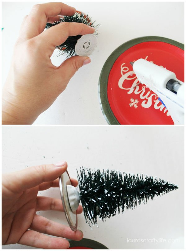 Use hot glue to glue the tree to the jar lid