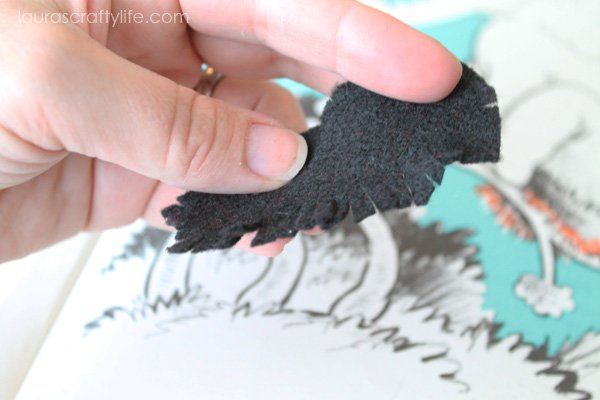 Cut a fringe into felt piece to create a nest