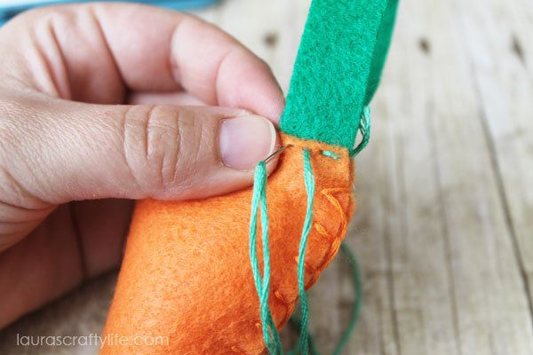 Continue running stitch until all carrot leaves are attached