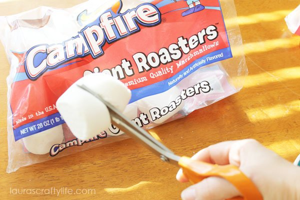Cut giant marshmallows in half using scissors