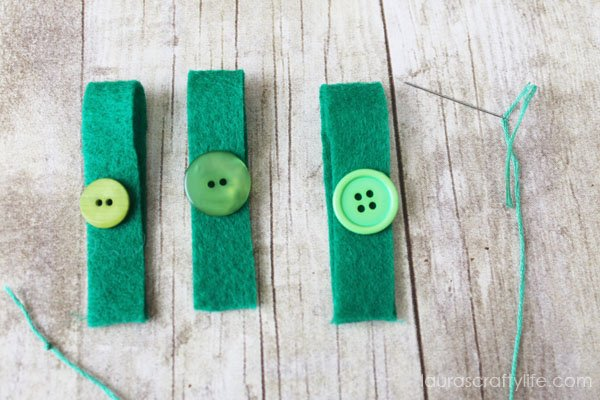 Embellish felt leaves with green buttons