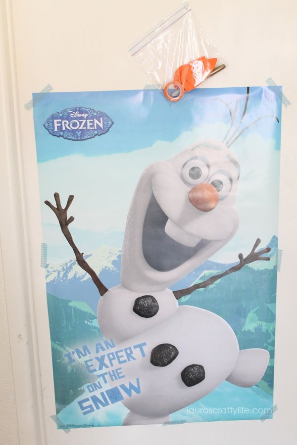 Use a poster to play Pin the Carrot Nose on Olaf at Frozen party - Laura's Crafty Life