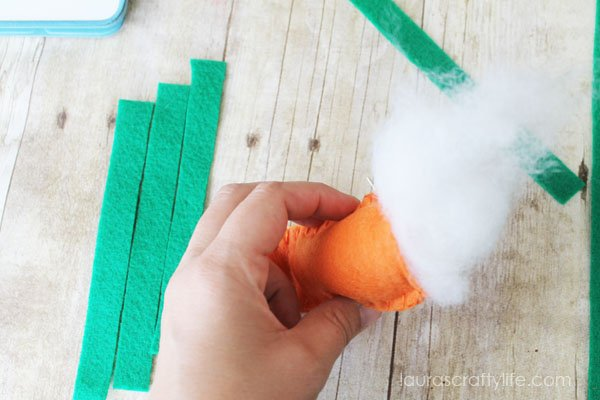 Use fiberfill to stuff carrot